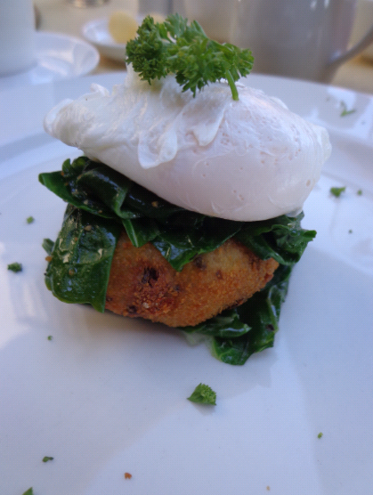 My breakfast on day 2: perfectly poached egg atop wilted spinach on a springbok droe wors potato cake