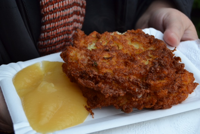 Fried potato fritters served with apple sauce - DELISH