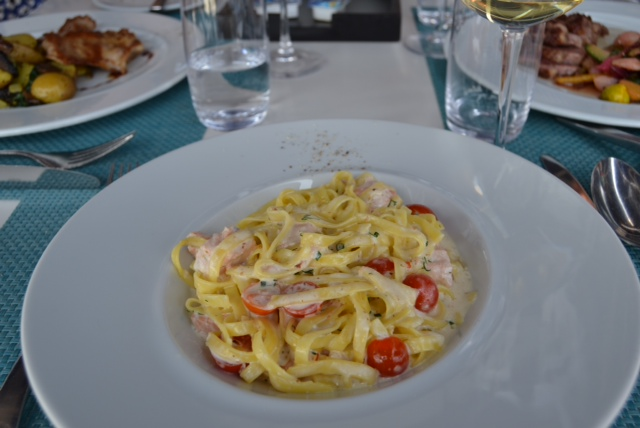 Sarah's Tagliatelline with fresh salmon, coconut sauce and fresh herbs - 13,50€