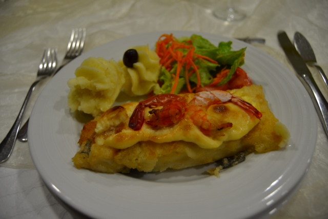 2nd course: Bacalhau fish topped with prawns, served with mash & salad